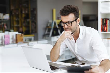pensive staring at laptop